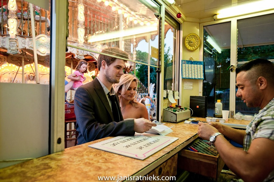 Two people buying tickets for carrousel in Paris wedding photo