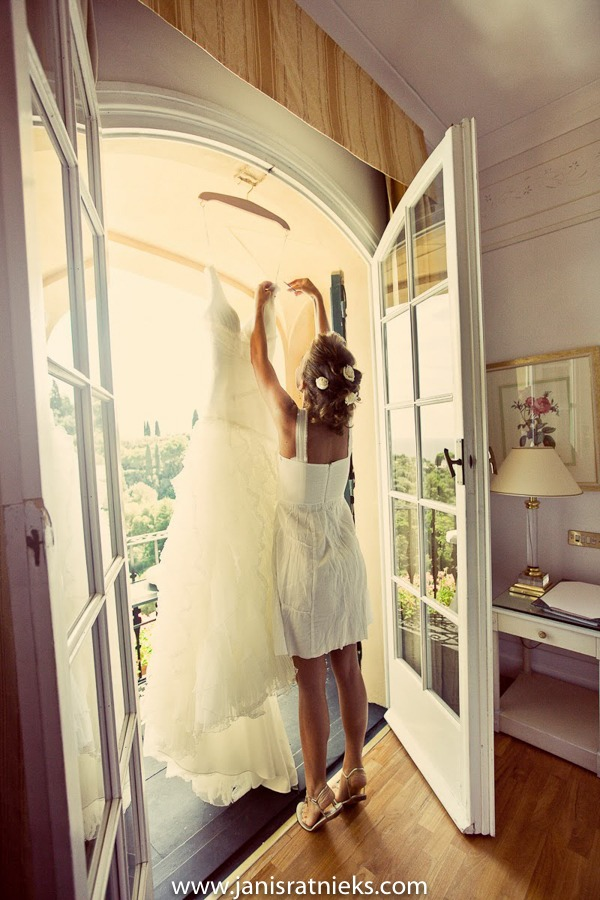 Hotel splendido wedding bride getting ready reaching for the dress
