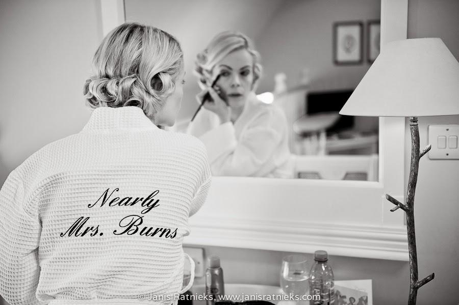 blonde bride getting ready bathroom