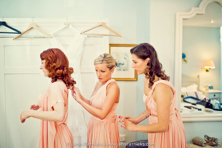 three bridesmaids fitting dresses